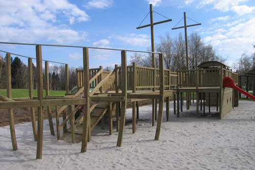 Treated wood children's playground structure.