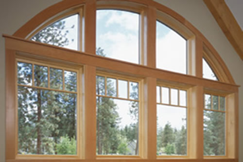 Wood windows protected with pressure treatment.